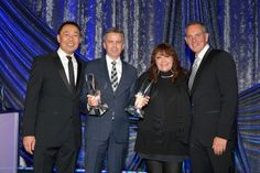 """MAY 14, 2015 (L-R) Assistant Vice President, Film/TV Relations at BMI Ray Yee, composer Brian Kirk, BMI Vice President of Film and Television Relations Doreen Ringer-Ross and BMI President and CEO Mike O'Neill pose with the BMI Film Music Award for """"NCIS: New Orleans"""" onstage during the 2015 BMI Film & Television Awards at the Beverly Wilshire Hotel on May 13, 2015 in Beverly Hills, California. (Photo by Lester Cohen/Getty Images for BMI)"""