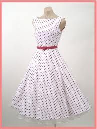 Retro  polka dots and red accents! Couldn't you just see a cute pair of read high heals and a red handbag?