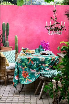 A colourful Morrocan style patio, but it could equally work in a garden room. Shocking Pink walls, tropical print table cloth, chandelier and indoor plants. Bring in the sunshine and recreate the ultimate idyll with these ideas Estilo Tropical, Tropical Home Decor, Tropical Houses, Tropical Furniture, Tropical Interior, Tropical Colors, Tropical Outdoor Decor, Morrocan Interior, Mexican Interior Design