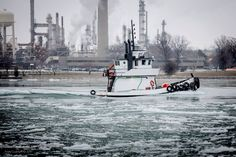 Such a cool photo.....tug looks like it's sinking, sitting so low in the ice on the St. Clair River, Port Huron/Marysville, Michigan