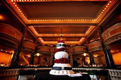 The cake, designed by Amy Beck, created an amazing sphere cake with touches of red and black.