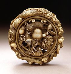Gyokuzan (Japan) Cluster of Felicitous Symbols, late 19th century Netsuke, Ivory with staining, sumi, metal and other inlays; ryusa type