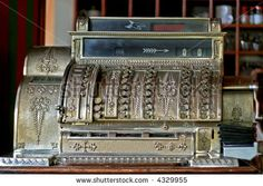 stock photo : Very old vintage style cash register close up