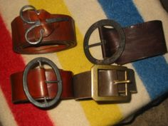 Assortment  of leather belts, some with hand forged buckles.