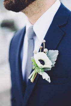 White anemone boutonierre | Romantic & Natural Beach Wedding Ideas via TheELD.com