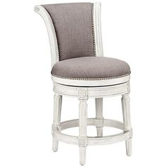 A pewter fabric counter stool with memory return swivel seat for added convenience.