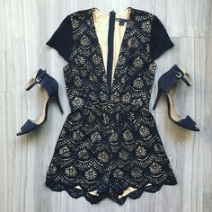 """Black Scallop Lace Deep V Romper Lace romper with low neck.  95% Polyester // 5% Spandex  Model is 5'8"""" wearing a Small. Dresses Mini"""
