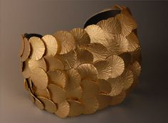 "Cuff | Maria Samora.  ""Seashell collection"".  18k royal yellow gold & oxidized sterling"