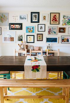 colorful gallery wall :: Living With Kids: Andrea Duclos, Design Mom Inspiration Wall, Interior Inspiration, Wooden Table And Chairs, Wood Table, Room Tour, Frames On Wall, Colorful Decor, Sweet Home, Dining Room