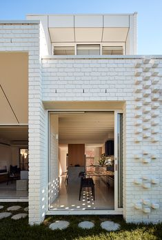 "An alteration & extension to a home in Northcote, Melbourne. ""Cherishing the small things produced a home that's efficient on space but big on heart"" (Photography by Peter Bennetts) Patio Grande, Art Deco, Western Wall, Heart Photography, Brick, Waterfall, Porches, New Homes, Photos"