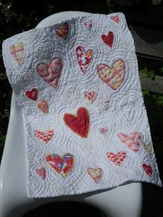 Heart quilt made with baby clothes.