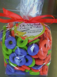 Italian Ring Cookies in your favorite colors.  These Ring Cookies are glazed in Red, Purple and Lime.  The perfect sweet to compliment any color scheme.  ohmysoulcookies-cakes.com