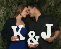 Forehead to forehead & initials with block letters.
