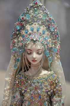 "Enchanted Dolls by Marina Bychkova ~ Snegurochka, 2004-2009. Materials:  Bead embroidery on fine silk with 476 Swarovski crystals, 76 Rhinestones, 1045 metal spheres, over thirty thousand glass seed beads. Porcelain, ball jointed, china paint, industrial springs, mohair wig, leather. 13.5"" (34.5cm) tall."