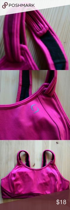 Moving Comfort Fiona Sports Bra ~ Blush/Crimson Best sports bra ever! I'm selling this for my sister but have my own and looove them. Great condition with some light piling seen in pics that can be removed.   The bestselling Moving Comfort Fiona sports bra blends comfort and support in a fit that works for nearly any body type. DriLayer®: 88% Polyester / 12% Spandex. Encapsulation/Compression. High-impact support. Seam-free interior molded cups. Front-adjustable straps with concealed…