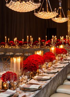 Everything from the pedestal vases to the mirrored runners reflected the romantic red of the roses and the soft glow of a seemingly endless array of candles. Check out this sparkling red dinner celebration.
