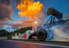 """Mark Rebilas (@rebilasphoto) on Instagram: """"Three time NHRA top fuel champion Antron Brown does a burnout in his Matco Tools dragster beneath a…"""""""