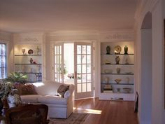 built ins & french doors in living room | CBi Design Professionals