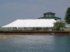 Tents that can go anywhere! Here's a 40 x 120 wedding tent on an small island in the middle of the lake. 844-TENT PRO