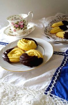 Pasticcini: easy and simply delicious, light, crumbly shortbread cookies, with one end dipped in chocolate, perfect afternoon tea time snack.