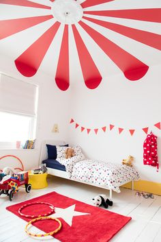 Give your kid's bedroom a circus theme with big top stripes on the ceiling. All you need is Pepper Red, White Cotton, Banana Split, and some masking tape. Find out how on Dulux.co.uk