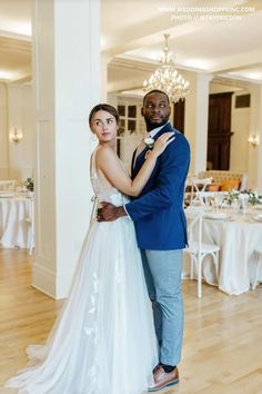 These two newlyweds are sharing a magical moment at their elegant wedding venue. The brides wedding gown looks stunning as it gracefully drapes the floor. The navy suit on the groom is both clean-cut and handsome. Shop all wedding attire with the Wedding Shoppe. Summer wedspiration | Indoor wedspiration | #navysuit | #weddingdresstrain | #elegantwedding Blush Pink Bridesmaid Dresses, Blush Pink Wedding Dress, Blush Pink Weddings, Gorgeous Wedding Dress, Wedding Dress Styles, Dream Wedding Dresses, Designer Wedding Dresses, Elegant Wedding, Wedding Gowns
