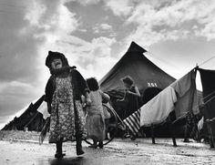 Robert Capa, Refugee Child Crying; Refugee Girl on Bags, Spain