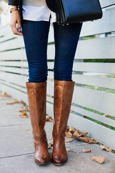 Long, sturdy, leather boots are a MUST for fall.