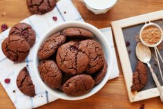 Chocolate cookies or biscuit with dried cranberries and milk