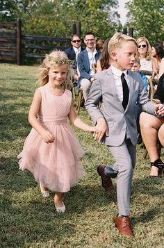 flower girl in pink tulle dress | image via: 100 layer cake