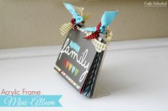 You know those clear plastic photo frames you see at dollar stores? Learn how to use one to display a standing mini album. Full Tutorial.