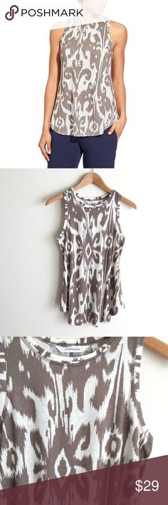 Athleta Ikat Print Bloom Breeze Tank Top 55% modal, 45% polyester.  High neck tank top.  White and taupe ikat print.  Semi-loose fit.  Excellent condition, like new. Athleta Tops Tank Tops