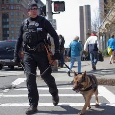 A Boston police officer with a bomb sniffing dog walks the perimeter of the cordoned off area the day after the Boston marathon bombing in Boston, Massachusetts on April 16, 2013. (Photo: Charlie Mahoney / Prime for NBC News) #Boston #BostonMarathon
