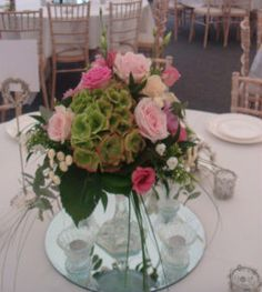 Centerpiece, place a mirror platter under Your Guest Table arrangements to make them look larger and fuller