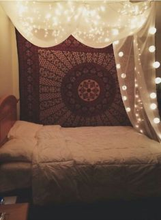Lights and canopy above bed