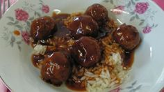 Meatballs are made with ground beef, onions, egg, and bread crumbs, browned in a skillet, and simmered with vinegar, soy sauce, cornstarch, ketchup, and sugar until the sauce thickens.