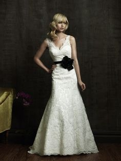 Scalloped v neck wedding dress. Maybe without the black sash though... the-dress