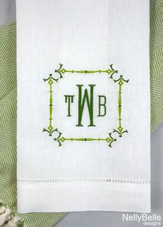 A chinoiserie monogram in greens on a linen guest towel. NellyBelle Designs