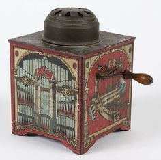 canary trainer music box - German tin music box originally used as an aid to encourage canaries to sing. early 20th cent.