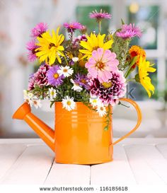 Watering can with Flowers and used as other décor!