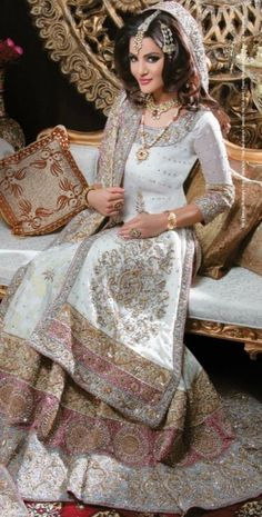 White and pink lehenga, a pretty alternative to red and green bridal.
