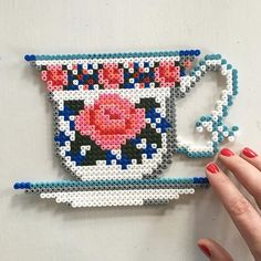 Floral tea cup hama beads by mitkrearum - Pattern: https://www.pinterest.com/pin/374291419009336462/