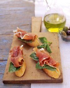 Prosciutto-Basil Crostini: baguette, evoo,  coarse salt,  ground pepper, basil leaves, 4 ounces thin prosciutto slices