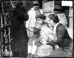 Lillian Singer and Irma Volger, holding a live turkey at South Water Street in the Loop, November 24, 1915. Photograph by Chicago Daily News. DN-0065517 #Thanksgiving #turkey #Chicago #history