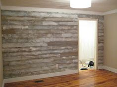 Distressed wood wall made with fencing panels. New wood white washed to look old!...neat idea!!