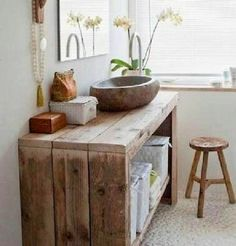 Check out this #rustic bathroom decor idea with a wooden sink and reclaimed wood vanity. Love it! #BathroomDesign #HomeDecorIdeas @istandarddesign