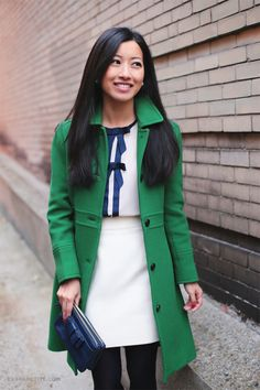 Green lady day coat and blue bows