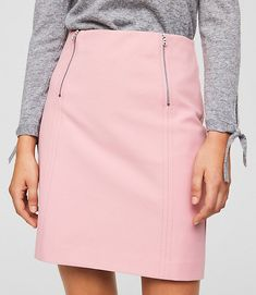 Double zip trim edges out this sleek shift skirt
