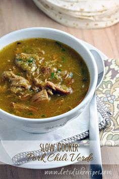 Slow Cooker Pork Chili Verde | Chunks of slow cooked pork in a slightly spicy green chili broth. Served with sour cream cheese and warm tortillas it's the ultimate comfort food!