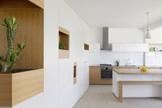 Completed in 2015 in Ramat Gan, Israel. Images by Gidon Levin. Located in Ramat Gan, neighbouring Tel Aviv, this apartment renovation prioritises an open and social spatial arrangement for family life to play...